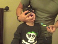 How A Dentist Brushes His Toddler'S Teeth - Batman.